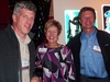 Zack Kretchmer '93, Carol Brown '99, and Steve Yemm '74 visit at the cafe reception.