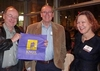 "Keith Maskus '76 with his ""Knox College"" tote bag prize along with Tom Perille '76 and Susan Rehak '75."
