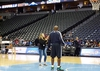 Raquel Gimenez gets her own personal coaching tips from the Nuggets staff membe