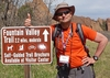Martin Stuber '77 poses by the Fountain Valley Trail sign as the 2.2 mile hike begins..