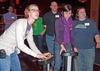 Leanne Lilly '06, Liam Harty '03, Rebeccah Bechtold '05, and Ashley Covington '05 work at programming the bowling lane screens.
