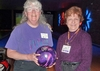 Proudly representing Knox '73 in purple/gold attire and with a purple-accented bowling ball, Joanne Parrish George and Nancy Bakos Hunter